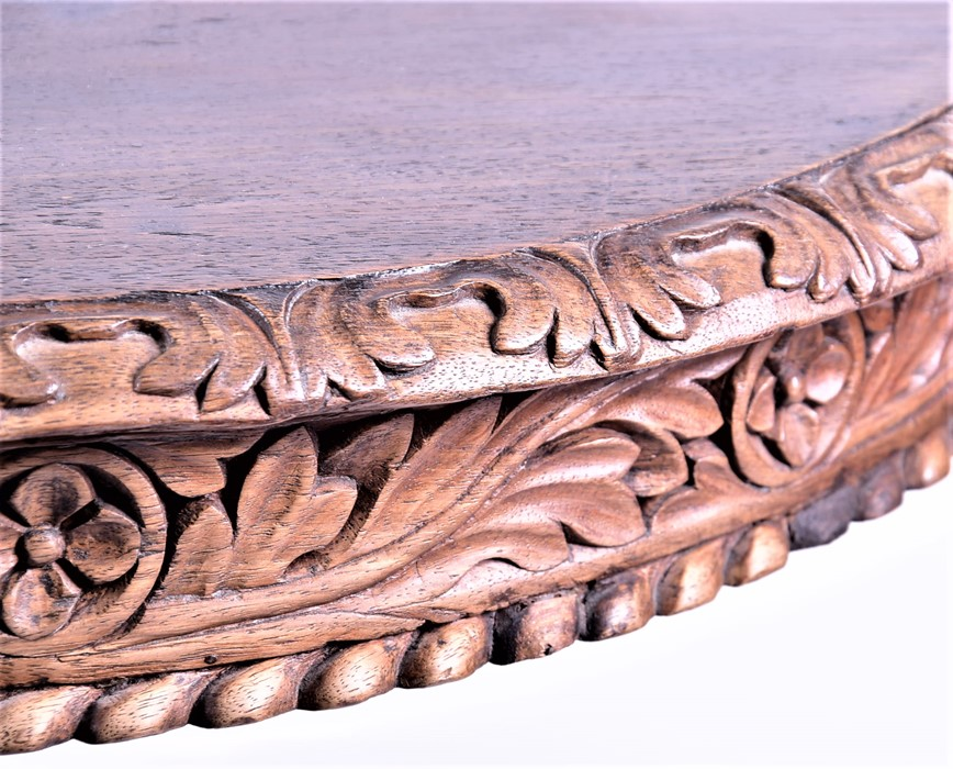 Lot 116 - Two carved hardwood Rajasthan circular tilt-top tables of similar proportions, one with feet