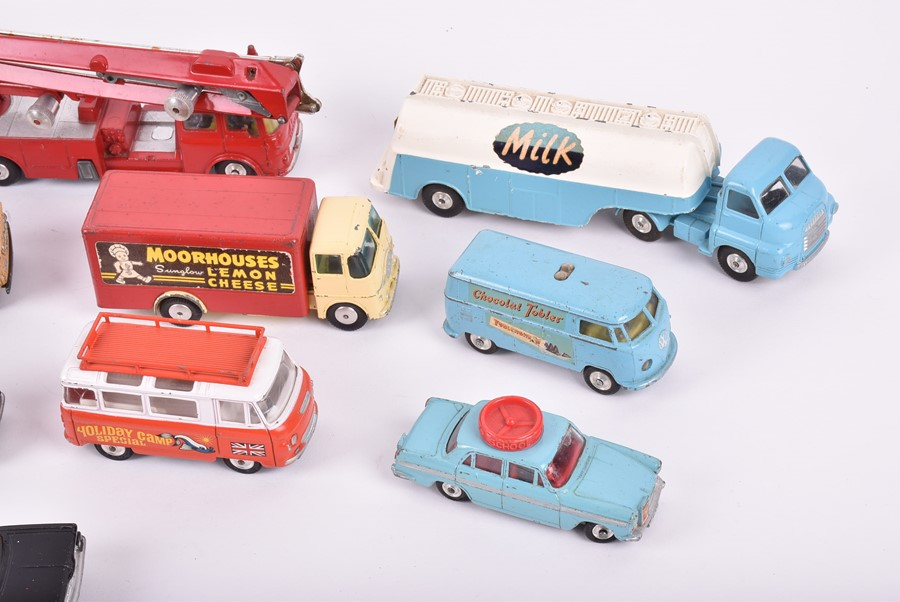 Lot 24 - A collection of fifteen loose and playworn Corgi diecast vehicles to include a 'Milk' Big Bedford