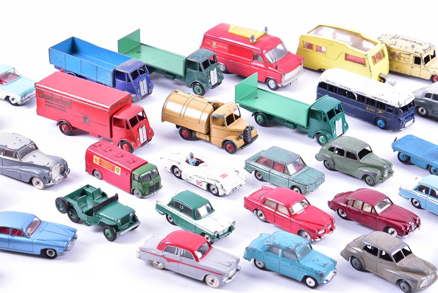 Lot 48 - A collection of loose and playworn Dinky Toys vehicles mid-20th century and later.