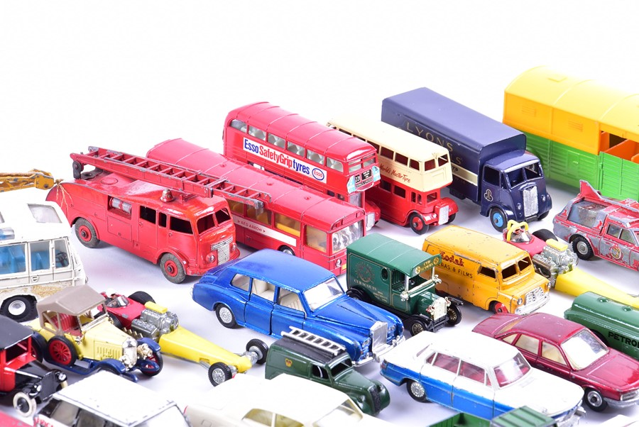 Lot 70 - Two boxes containing a large quantity of loose and playworn Corgi, Dinky and other diecast vehicles.