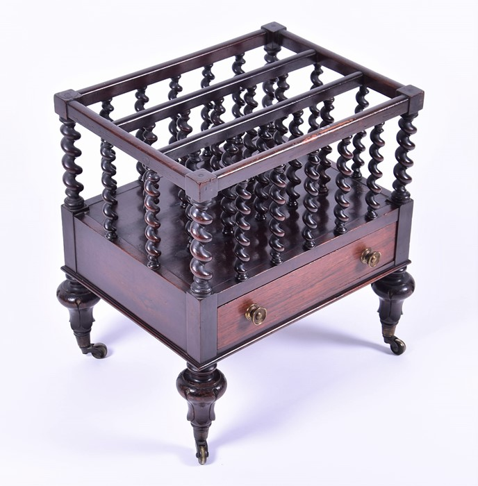 Lot 108 - A Victorian rosewood three division Canterbury with twin handled front drawer and twist turned bars,