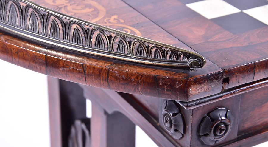 Lot 104 - An unusual George IV rosewood & marquetry games table the galleried side flanking a sliding and