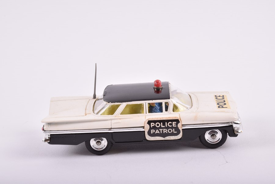 Lot 9 - A Corgi Toys 419 Ford Zephyr Motorway Patrol vehicle together with a 439 Chevrolet Fire Chief, a