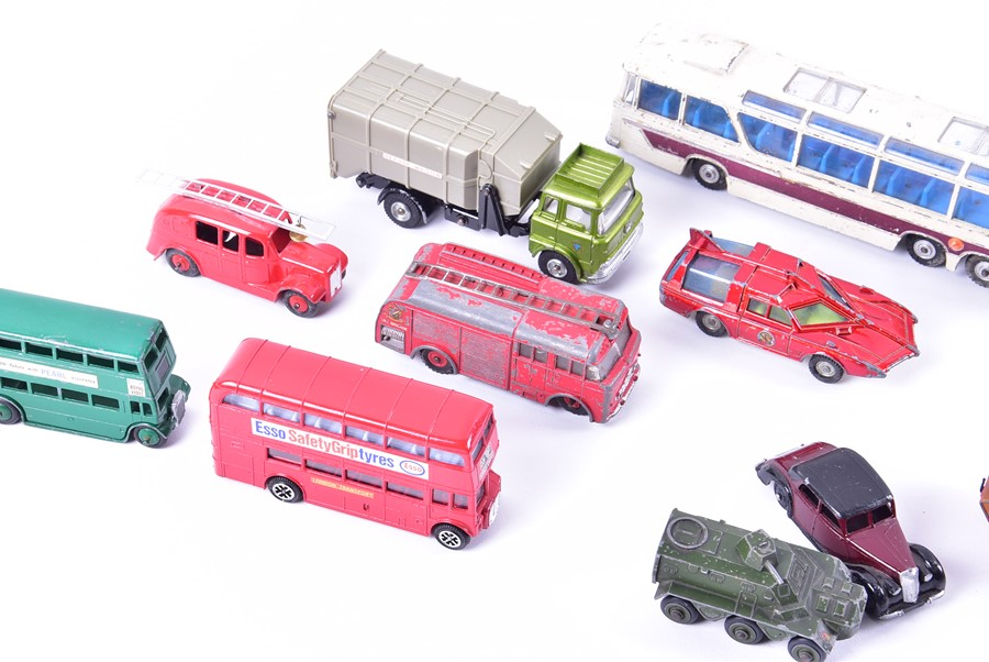 Lot 34 - A collection of loose and playworn Dinky diecast vehicles to include buses, emergency vehicles,