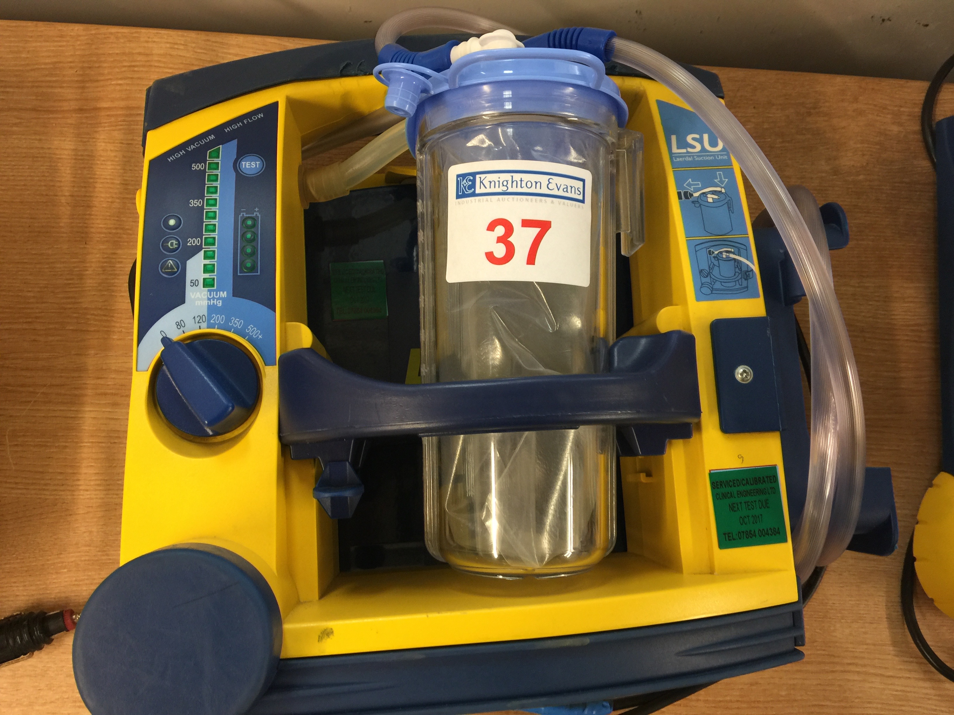 Lot 37 - Laerdal LSU portable suction unit with mounting plate and 12v charger, test due October 2017