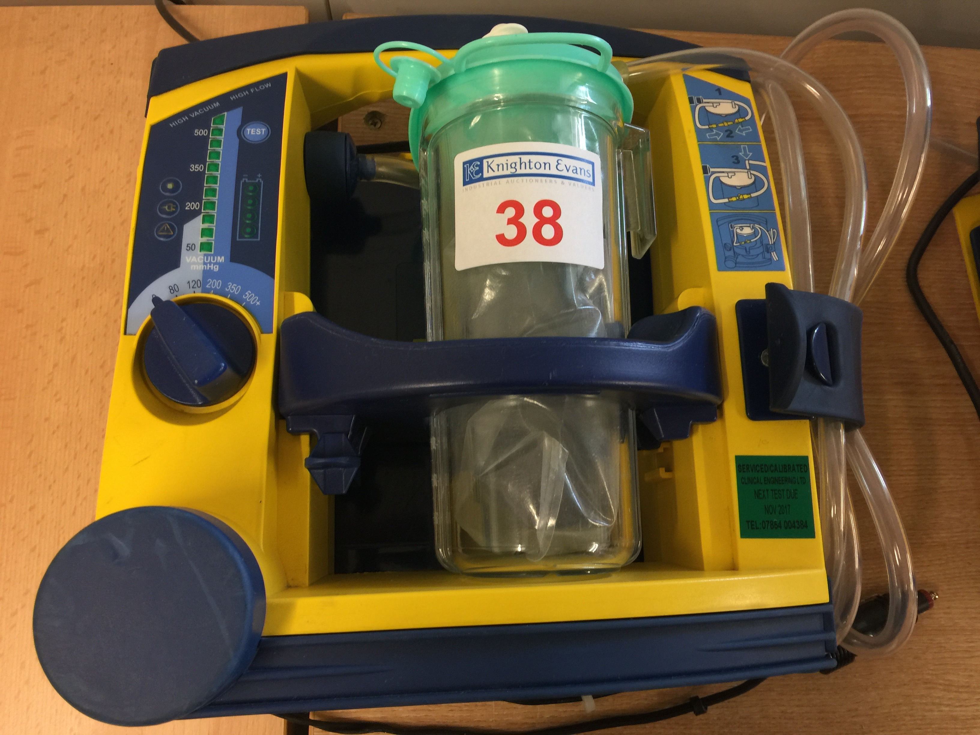 Lot 38 - Laerdal LSU portable suction unit with mounting plate and 12v charger, test due November 2017