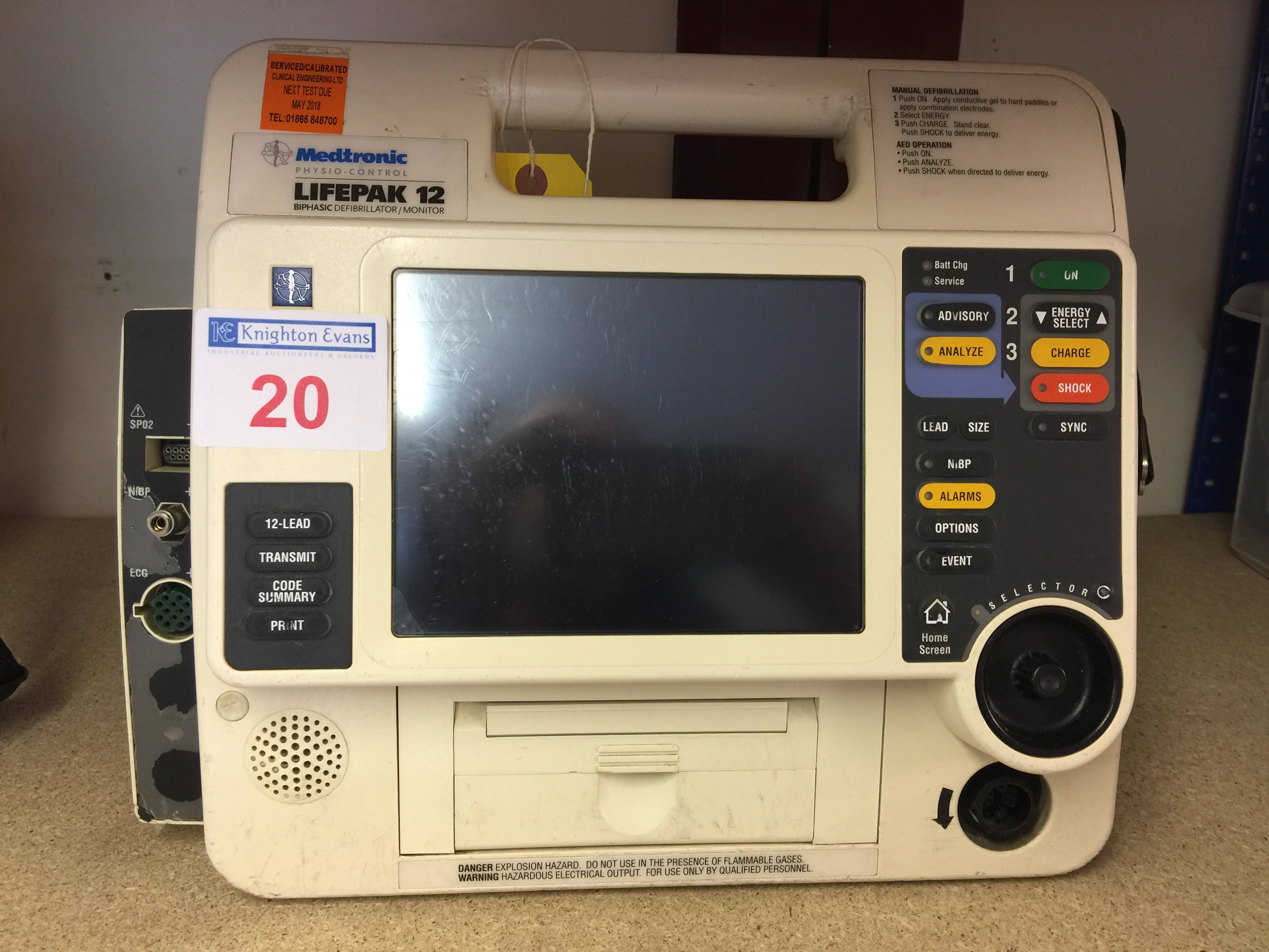 Lot 20 - Medtronic Physio Control Life-Pak 12 portable defibrillator base unit with batteries, test due May
