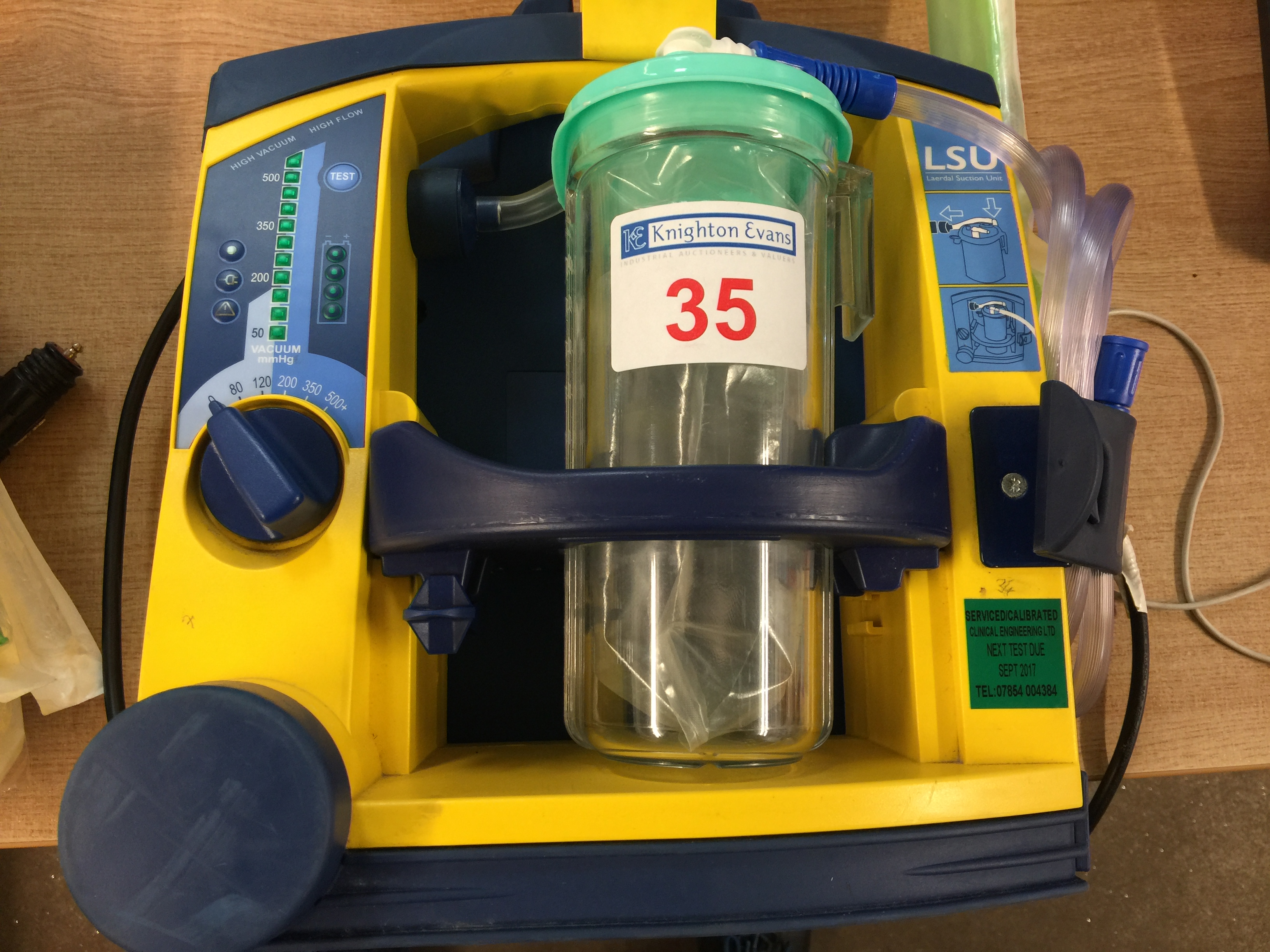 Lot 35 - Laerdal LSU portable suction unit with mounting plate and 12v charger, test due September 2017
