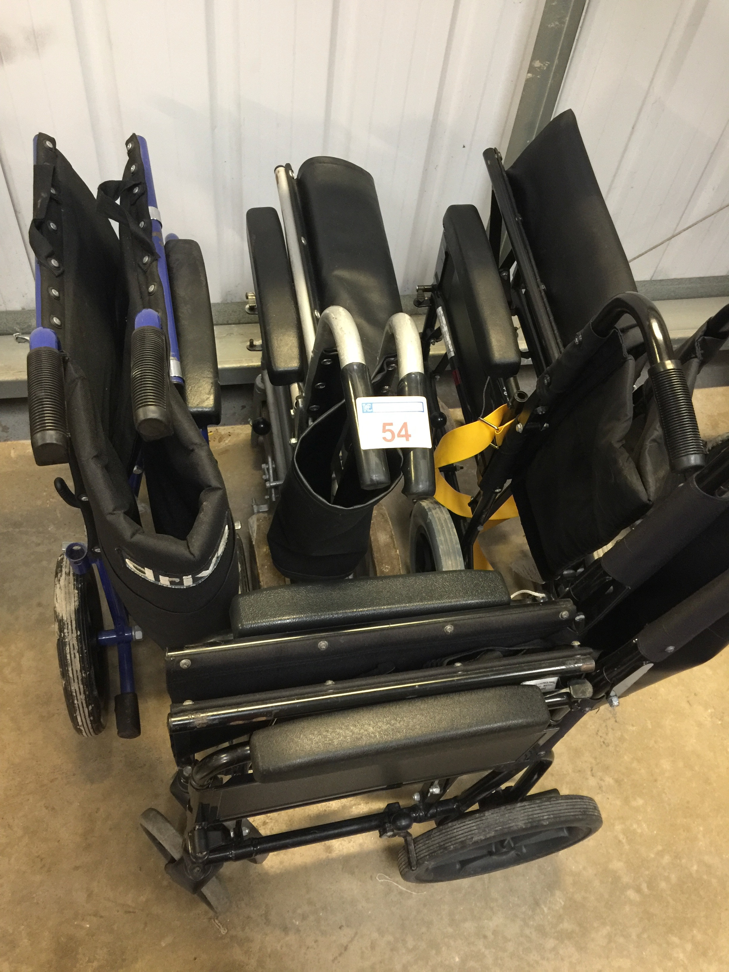 Lot 54 - 4 folding transit wheelchairs