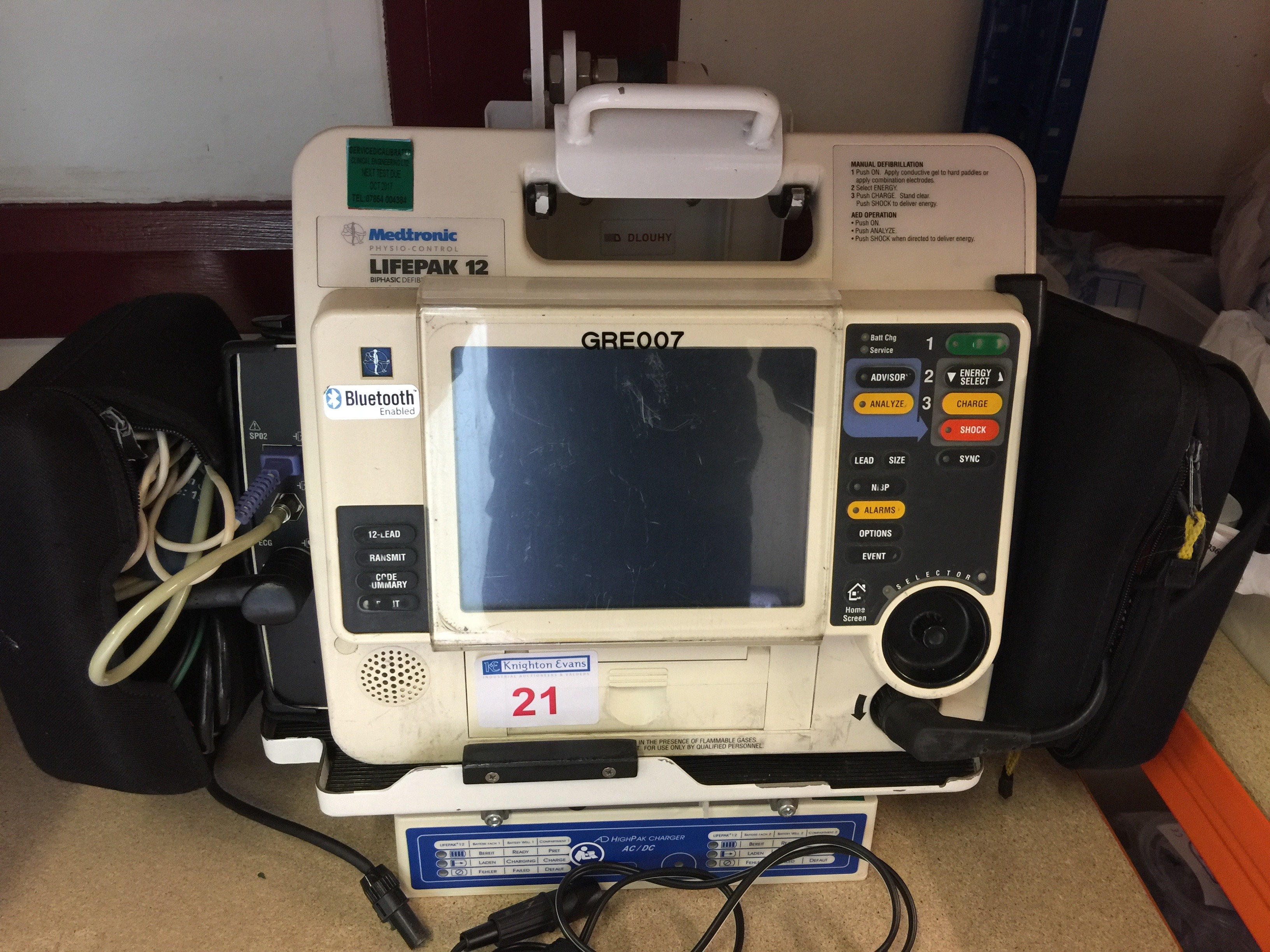 Lot 21 - Medtronic Physio Control Life-Pak 12 portable defibrillator with wall bracket, charger, leads and