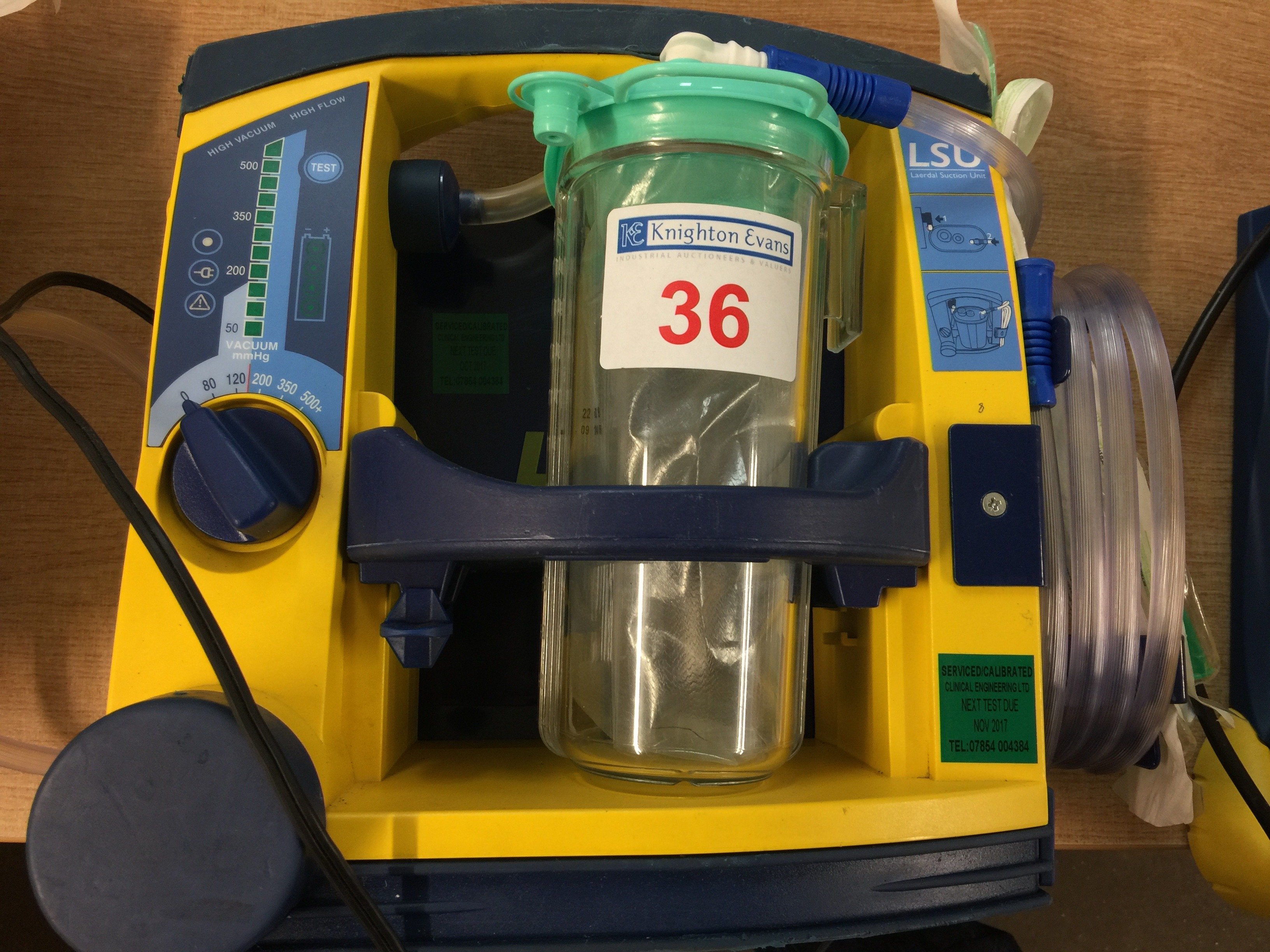 Lot 36 - Laerdal LSU portable suction unit with mounting plate and 12v charger, test due November 2017