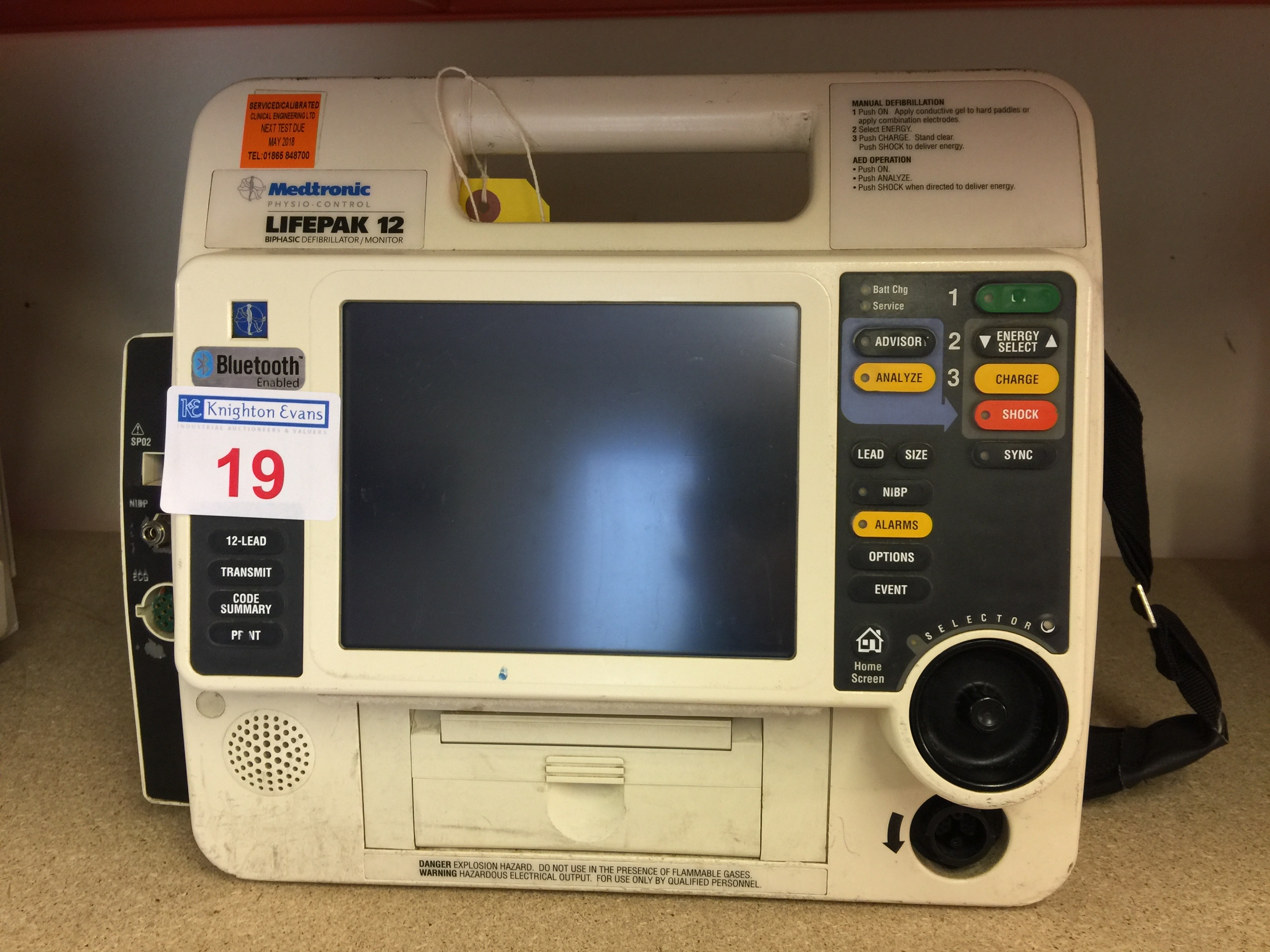 Lot 19 - Medtronic Physio Control Life-Pak 12 portable defibrillator base unit with batteries, test due May