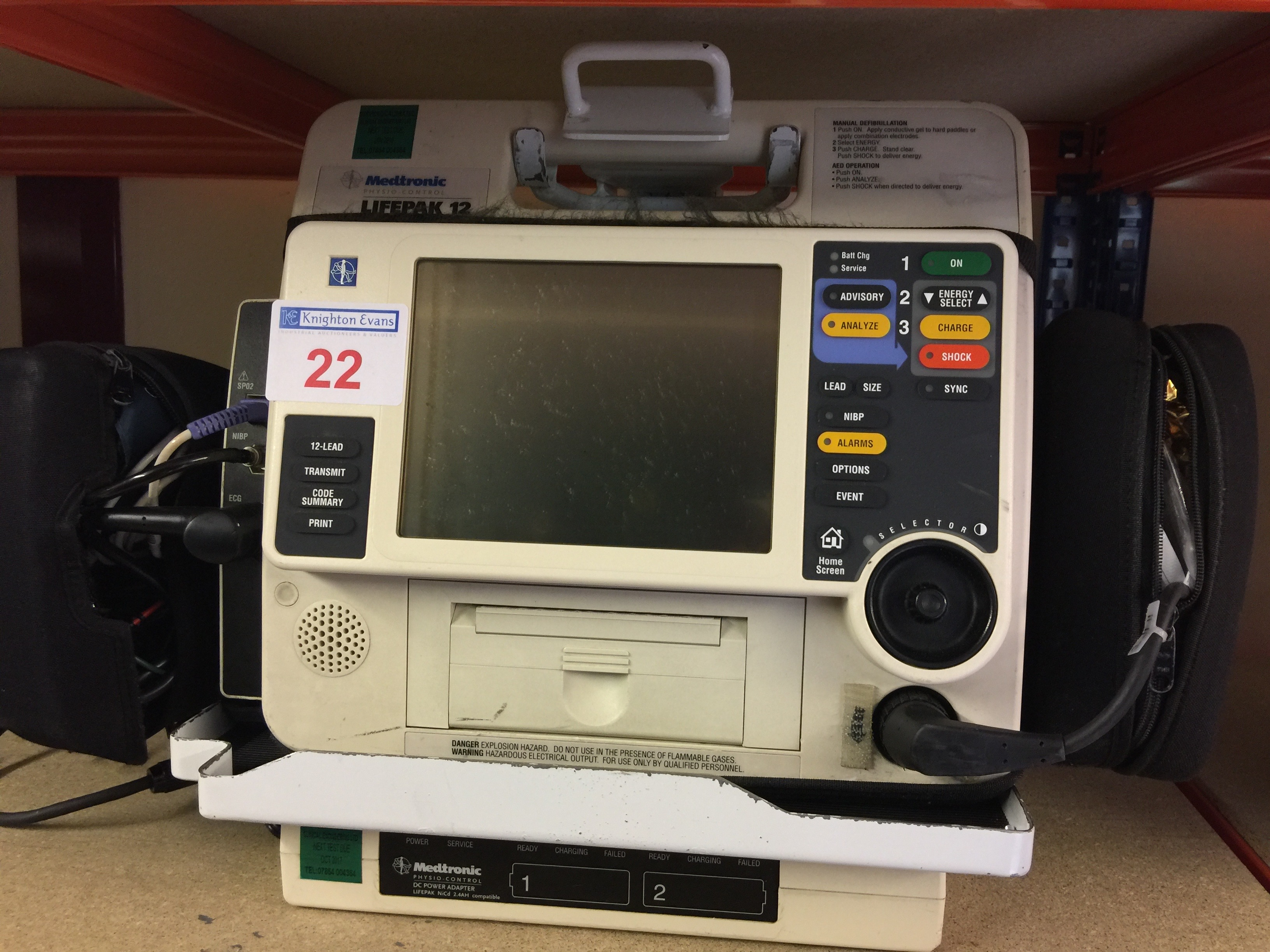Lot 22 - Medtronic Physio Control Life-Pak 12 portable defibrillator with wall bracket, charger, leads and