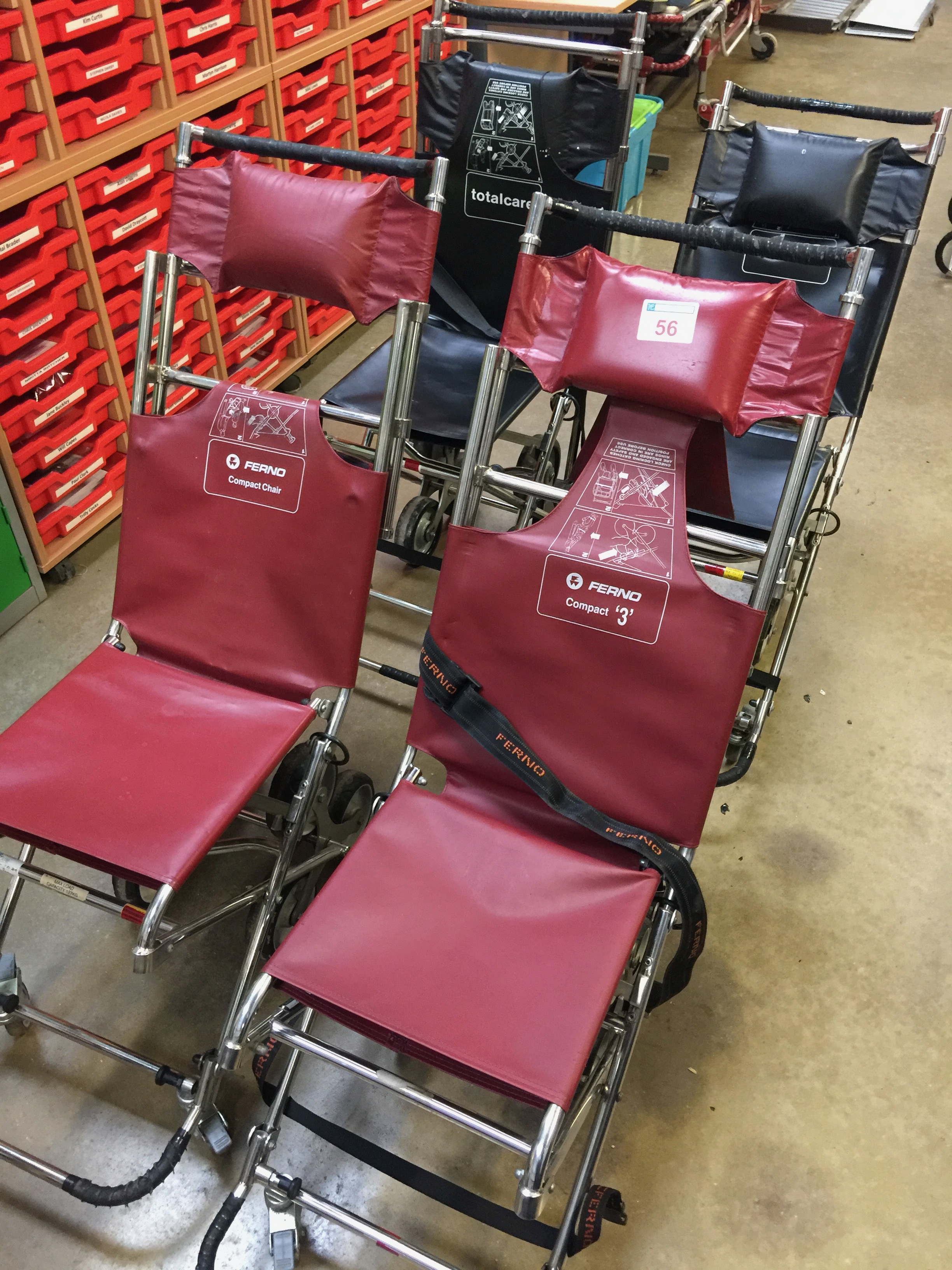 Lot 56 - 2 Ferno Compact  carry chairs and 2 Total-Care carry chairs