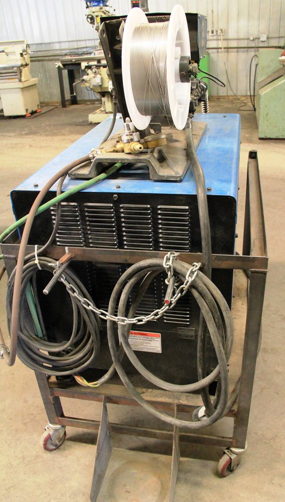 Lot 30 - MILLER DIMENSION 452 ELECTRIC WELDER, DIGITAL READ-OUT, MILLER S-54E WIRE FEEDER MOUNTED ON CART,