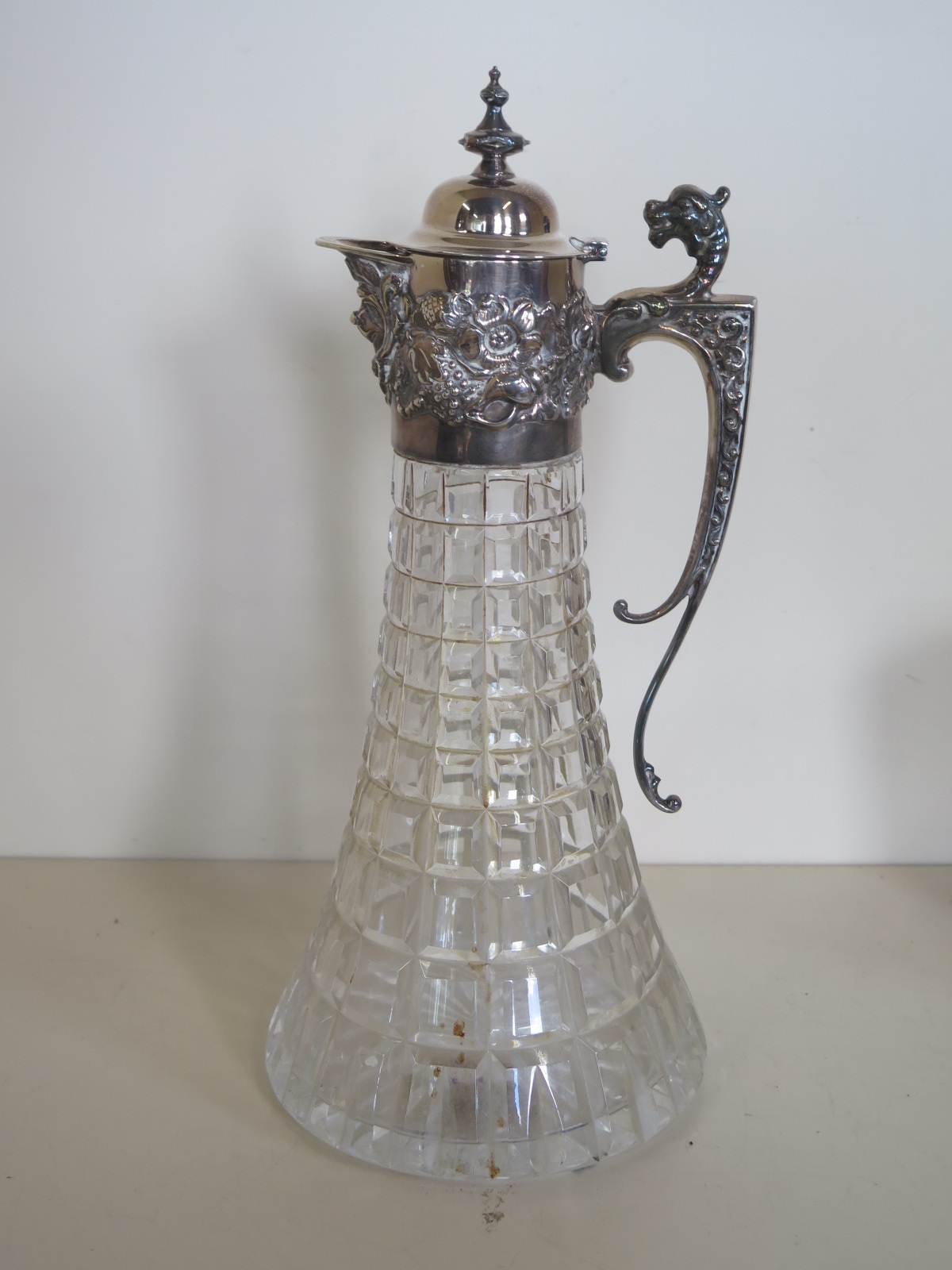 Lot 569 - A silver topped glass clarinet jug, Sheffield 1972, approx 31cm high, usage marks