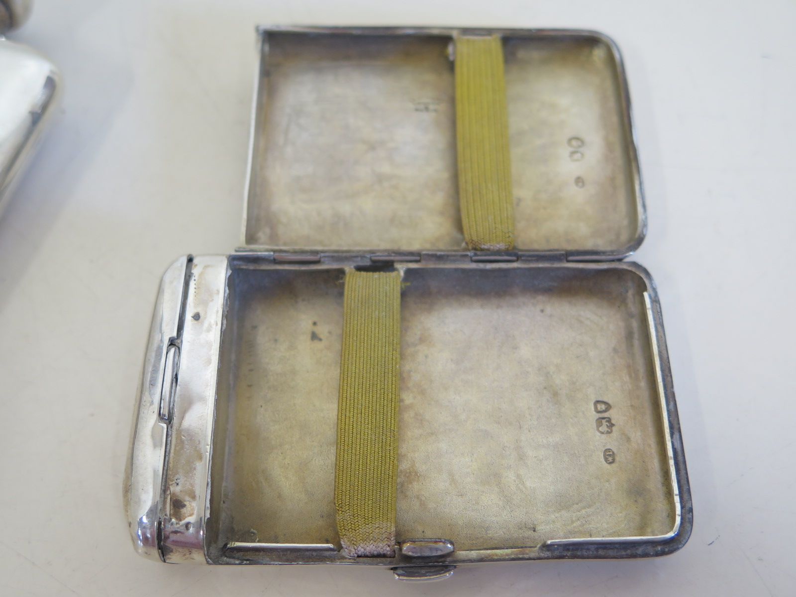 Lot 570 - A Victorian cigarette case and silver hip flask, approx 4.9 troy oz, both with small dents and usage