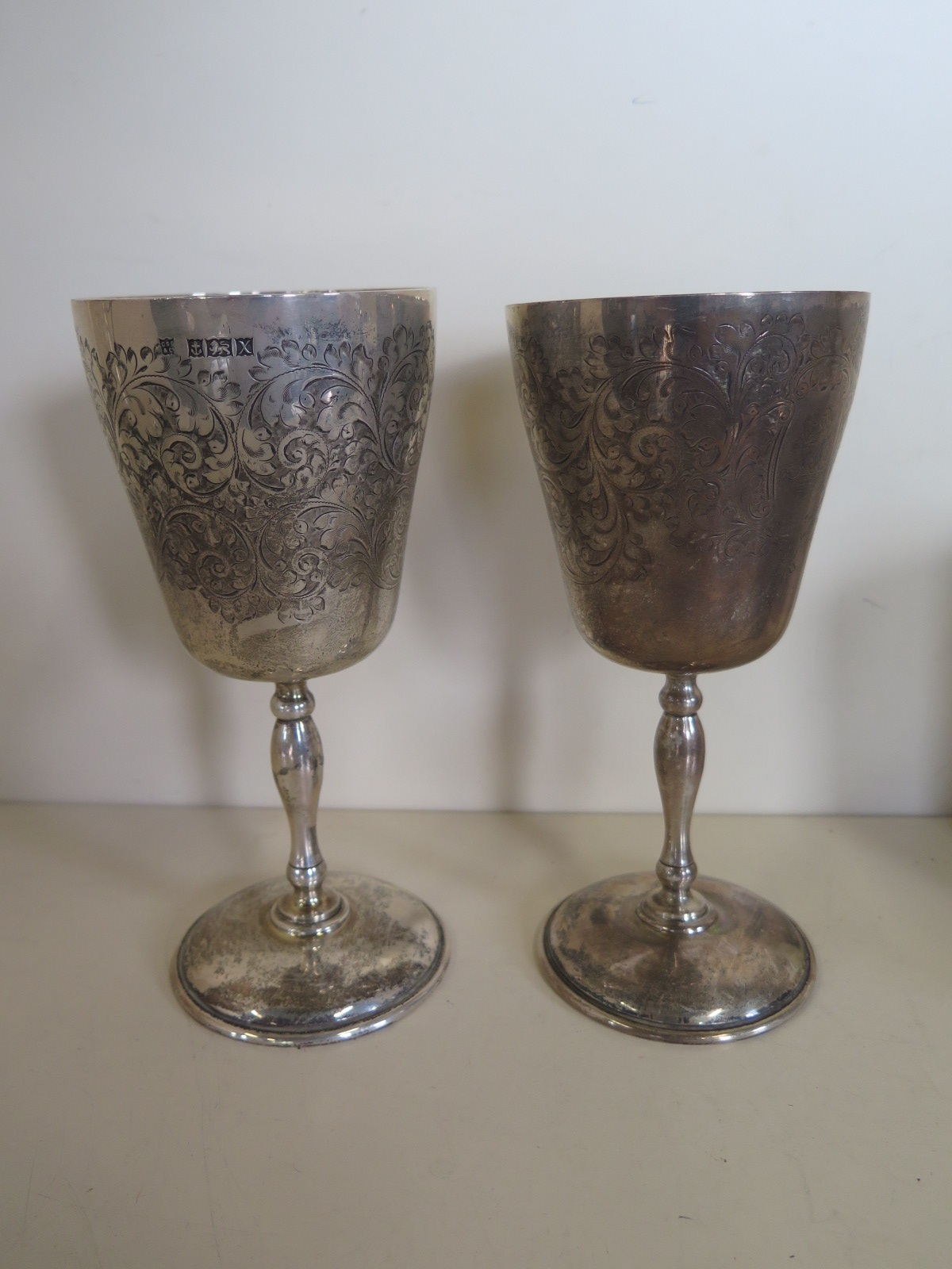 Lot 568 - A pair of silver goblets, Birmingham 1972, approx 17.5 troy oz, approx 17.8cm high, usage marks