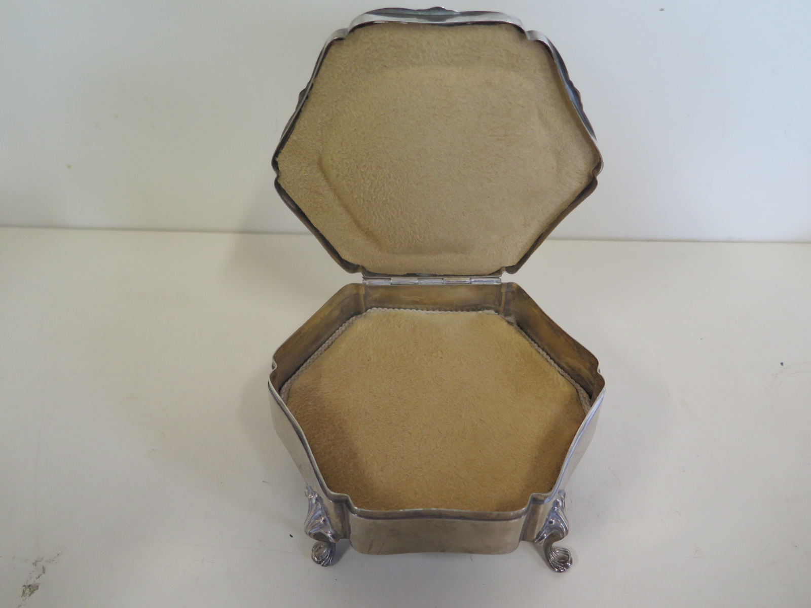 Lot 599 - A large hexagonal silver and tortoiseshell jewellery casket on four legs with pad feet - approx 12cm