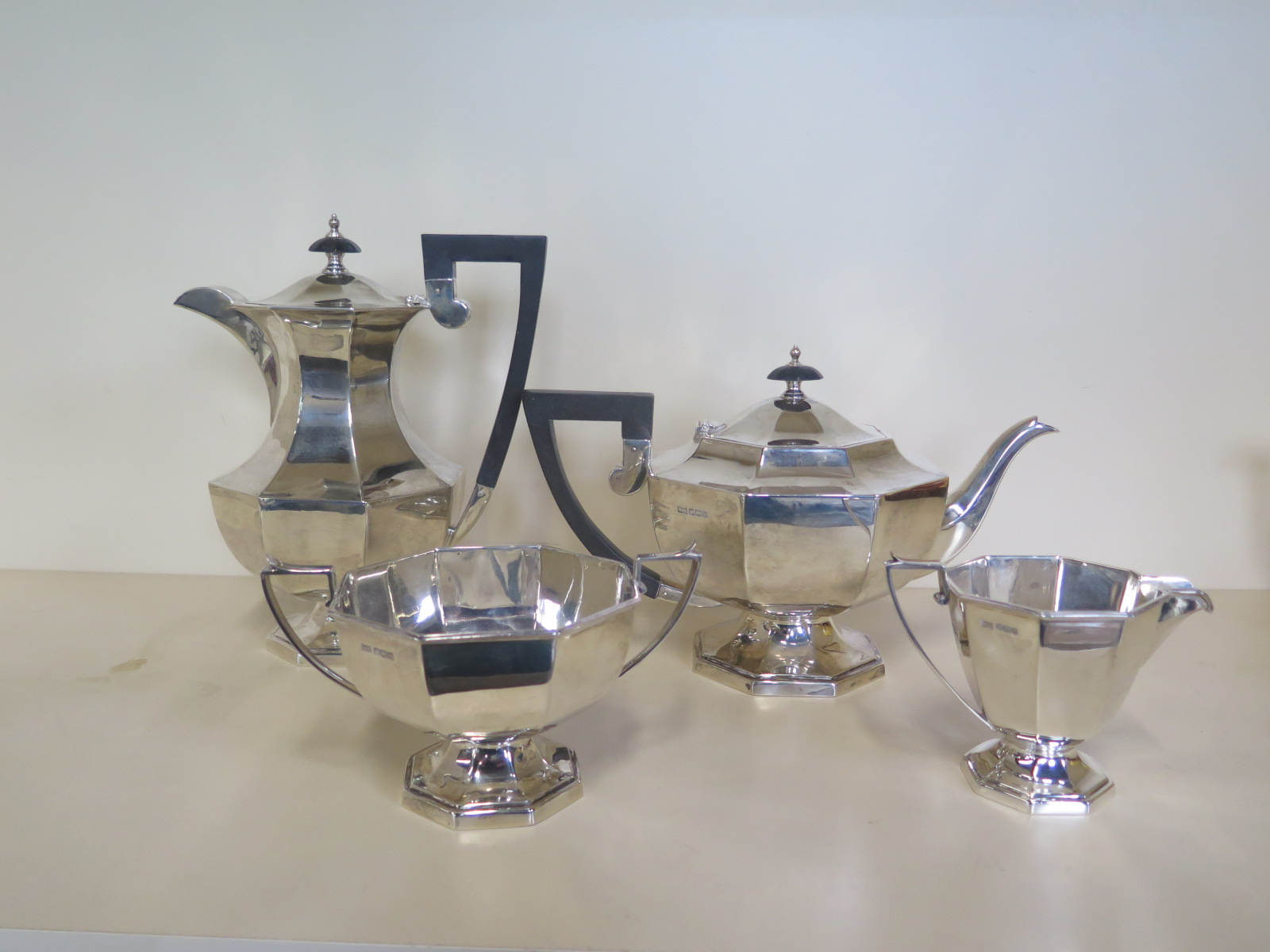 Lot 551 - A silver Walker and Hall four piece tea set, Sheffield 1925/26 water jug, 1927/28 - total weight ,