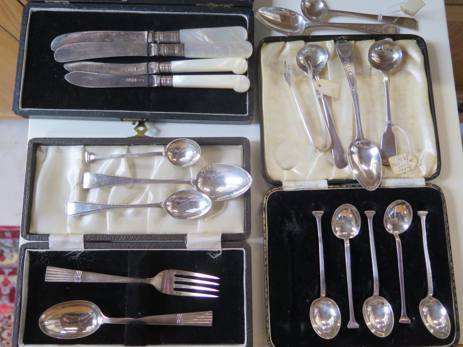Lot 579 - Eight pieces of silver flatware, and a cased set of six spoons, knife and fork and two silver bladed