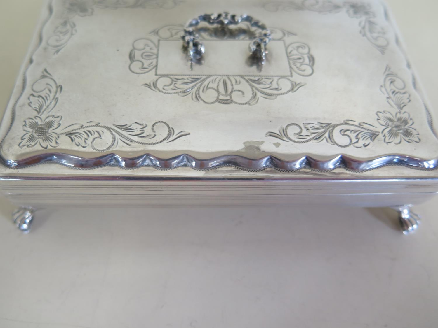 Lot 580 - A near pair of Dutch trinket boxes, one in dutch silver, the other plated, 3.5cm tall x 13cm x 9cm -