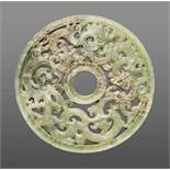 A UNIQUE LIGHT GREEN JADE DISC WITH AN INTRICATE OPENWORK DESIGN OF DRAGONS AND PHOENIXES Jade,