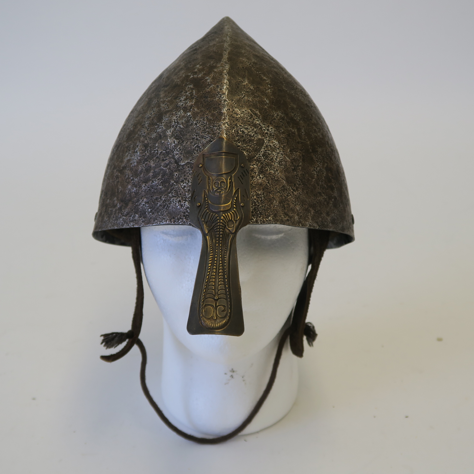 Lot 40 - Viking style movie prop metal helmet with leather chin strap,
