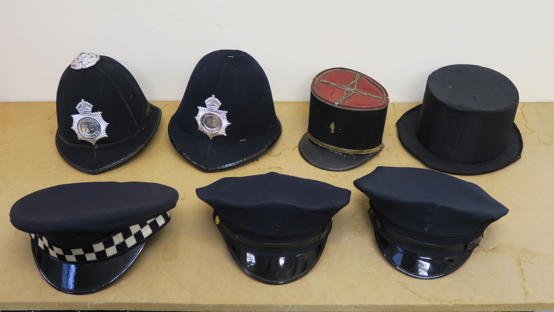 "Lot 56 - Police helmets - two of American style with peak caps (size 7 3/8""),"