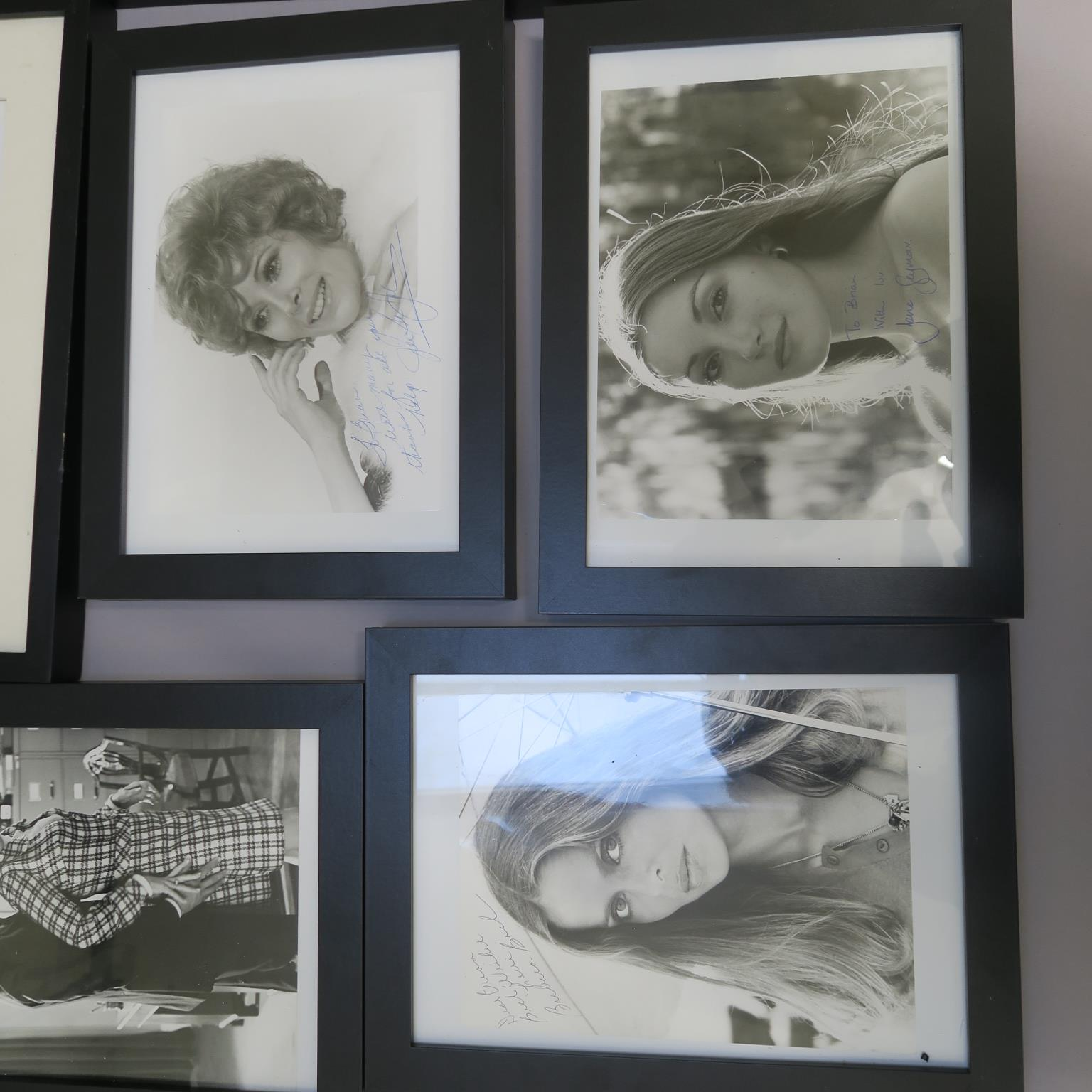 Lot 34 - Collection of framed photographs with personally signed photos from the Bond Girls - Jane Seymour,