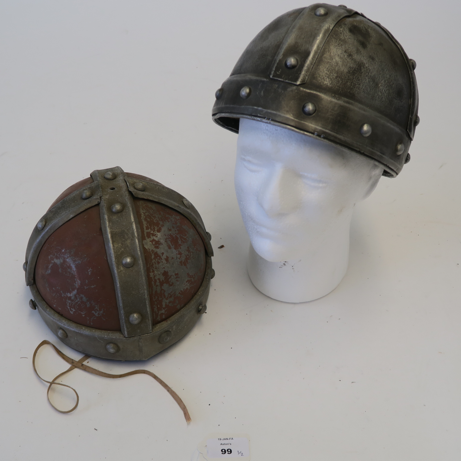 Lot 51 - Two Robin Hood movie prop helmets (Errol Flynn era) worn and showing signed of rust with metal