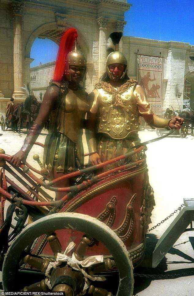 """Lot 55 - """"Gladiator"""" (2000) Chariot Driver gold foam backed armour movie prop of gold coloured metal"""