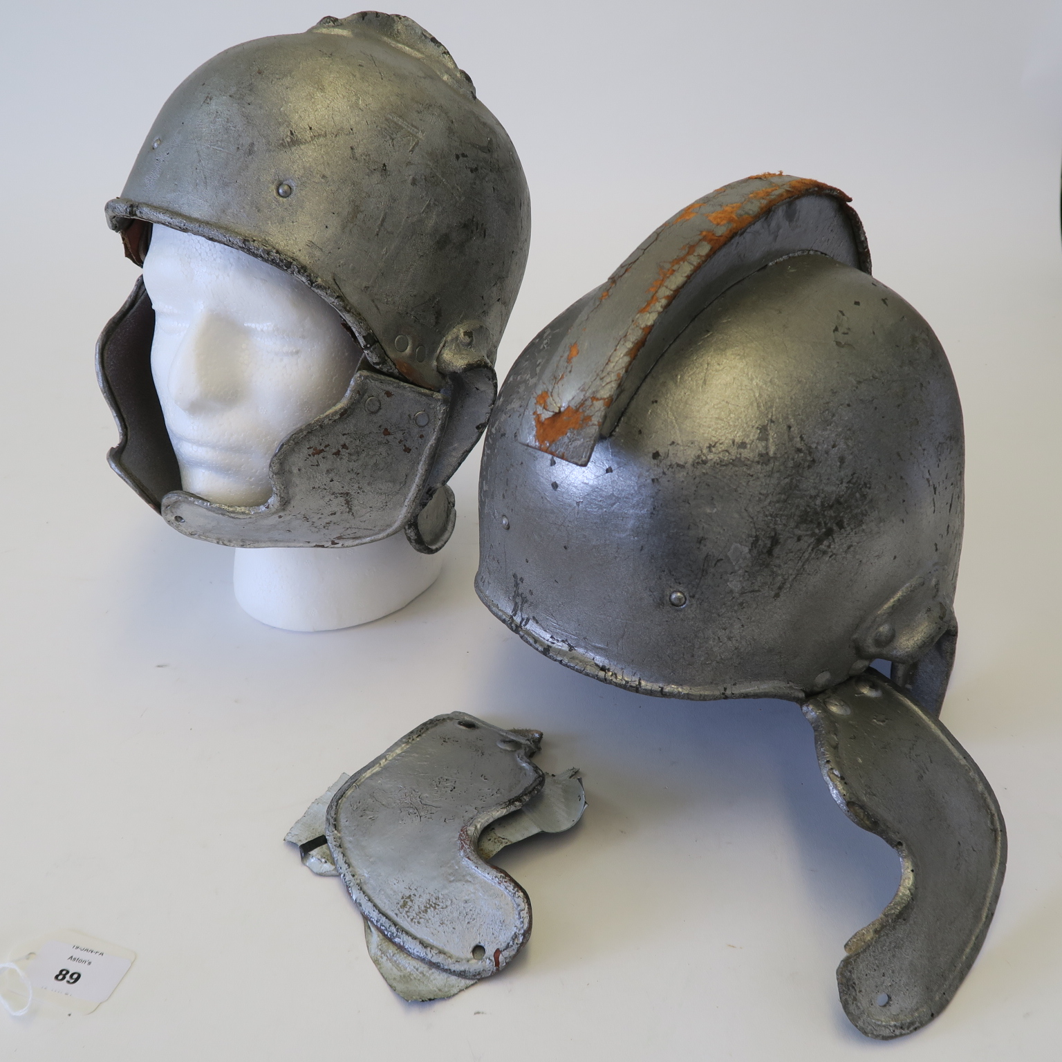 Lot 43 - The Greatest Story Ever Told screen used Two Roman style movie prop helmets - silver helmets with