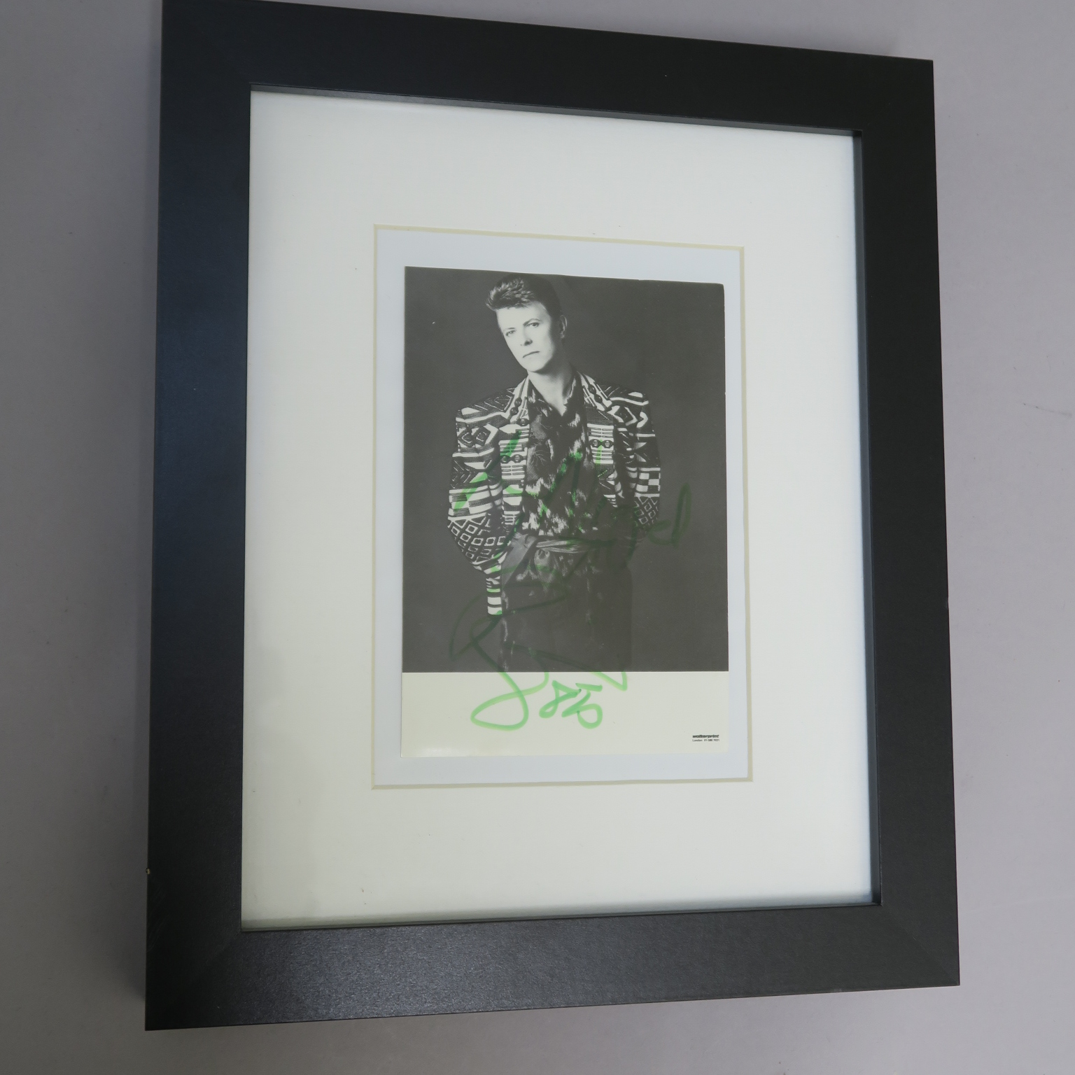"""Lot 32 - David Bowie hand signed Walker print of London photo signed """"To Nigel David Bowie"""" dated 1985 in"""