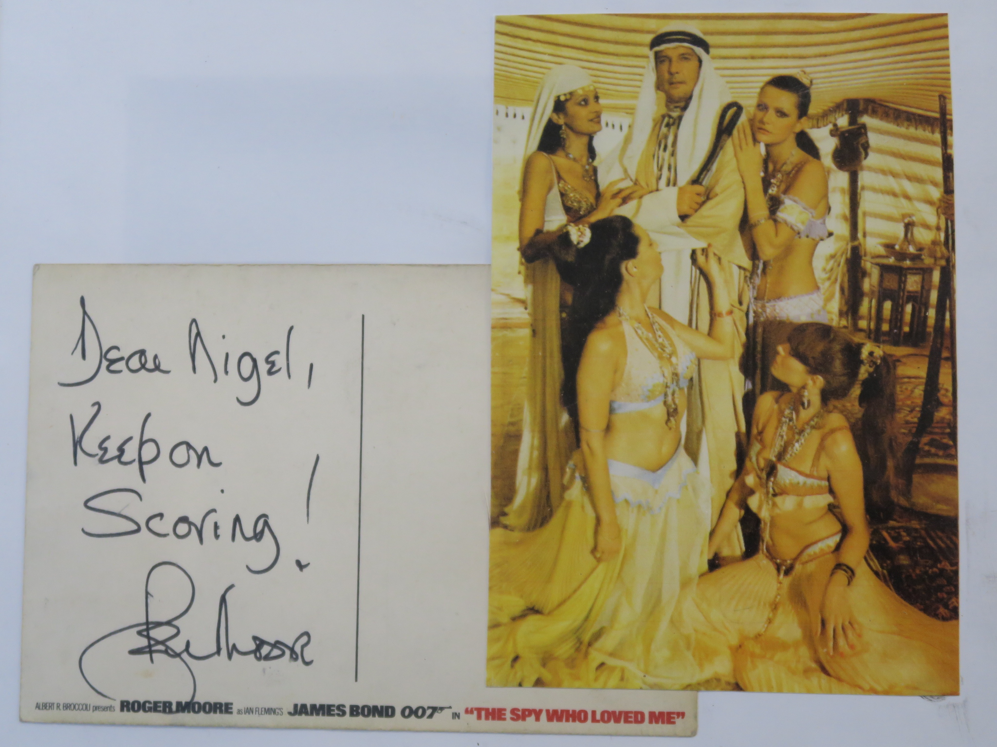 Lot 33A - Roger Moore handwritten postcard to the son of the Production Accountant written on The Spy Who