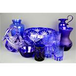 A collection of blue Bohemian and other glass.