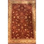 A large red wool rug, size 199 x 299cm.
