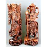 Two Chinese carved hardwood figures of guardian deities, H. 41.5cm. (A/F to one hand)