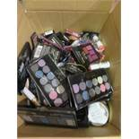 Circa. 200 items of various new make up acadamy make up to include: lipstick, glow beam highlighting
