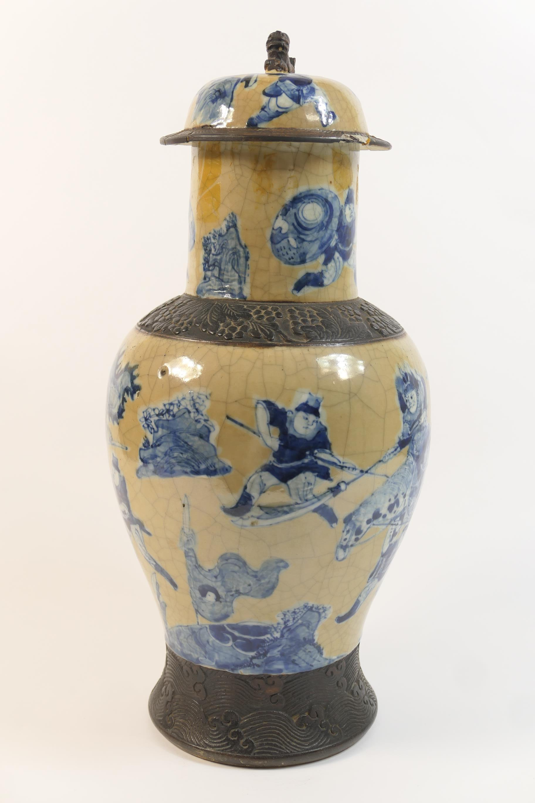 Lot 13 - Chinese crackle ground lidded baluster vase, circa 1900, decorated in underglaze blue with