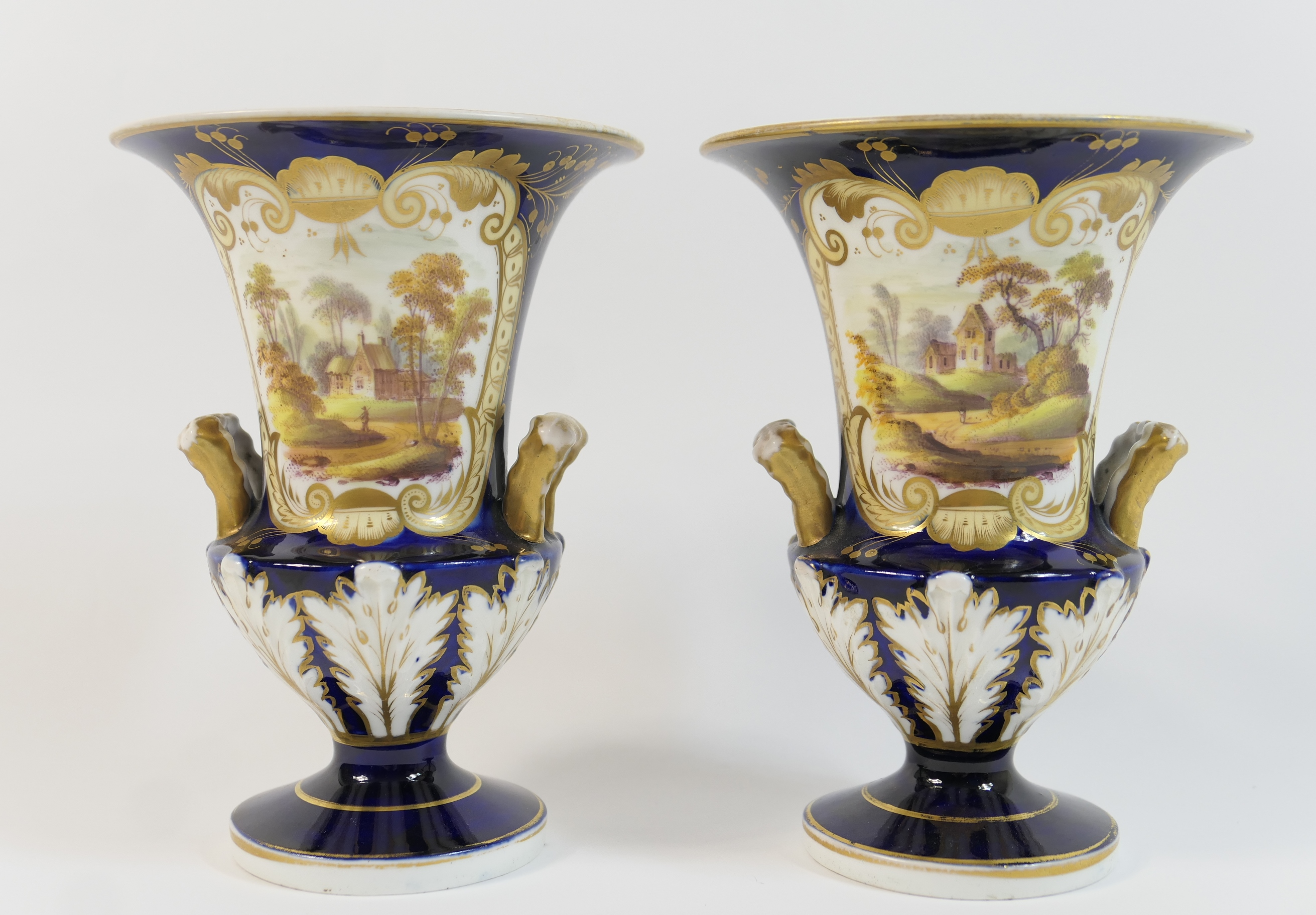 Pair of Victorian china vases, circa 1845, of slender campagna form, decorated with a landscape