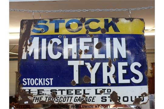 A Michelin Tyres enamel sign with H E  Steel Ltd, The Truscott