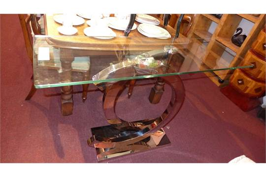 A Coco Chanel Designer Console Table, The Heavy Plate Glass Top Raised On  Shaped Chromed Supports
