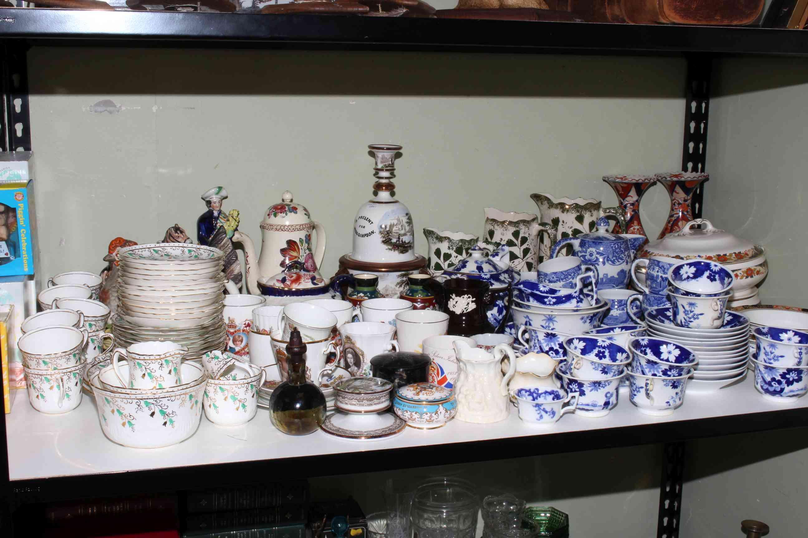 Lot 67 - Shelf of ceramics including tureen, commemorative, teapots and framed prints, etc.