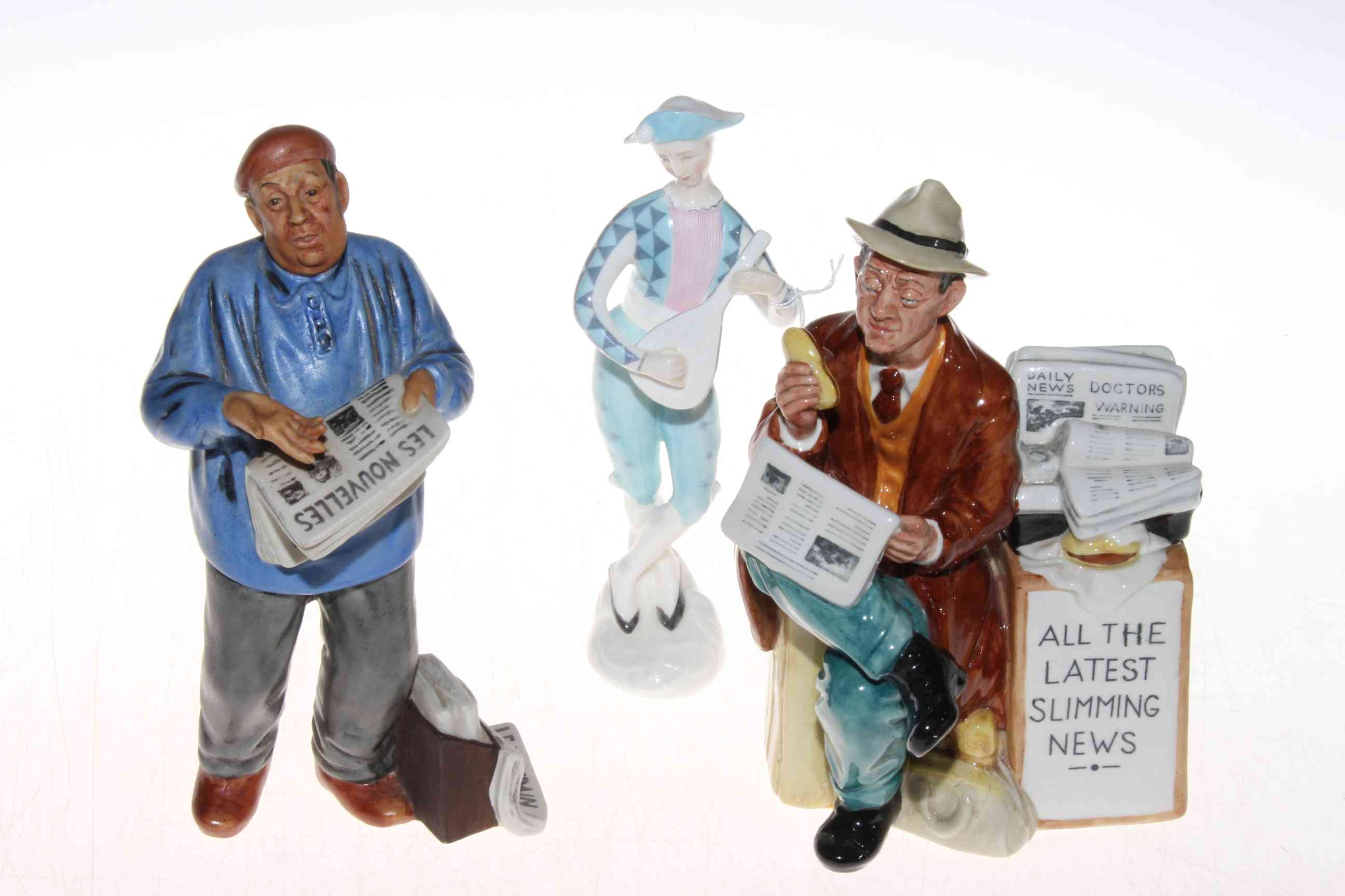 Lot 331 - Three Royal Doulton figurines, Stop Press, The Parisian and Harlequin (3).