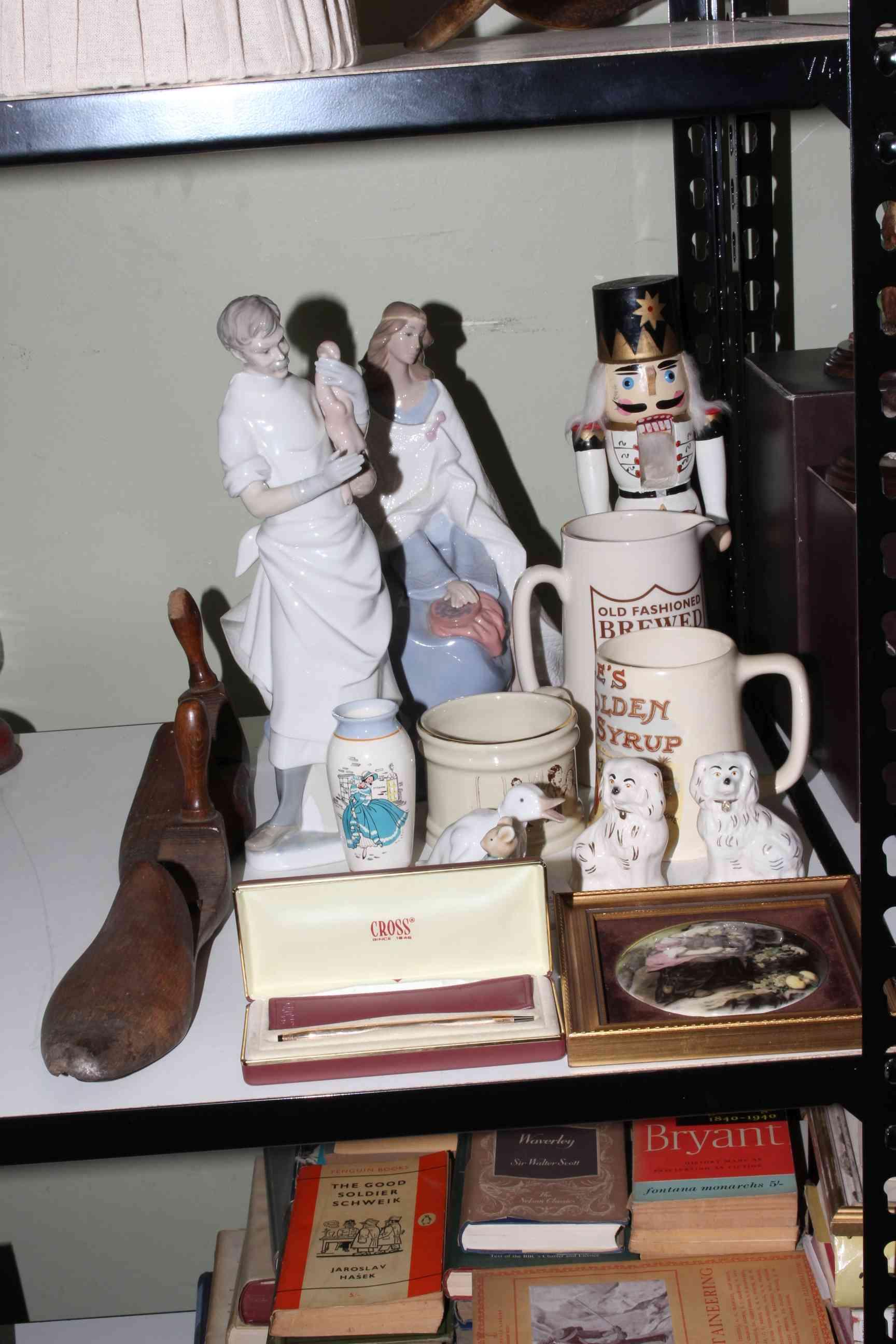 Lot 69 - Wooden shoe shapers, Nao and Lladro figurines, Wade, cross pen, etc.