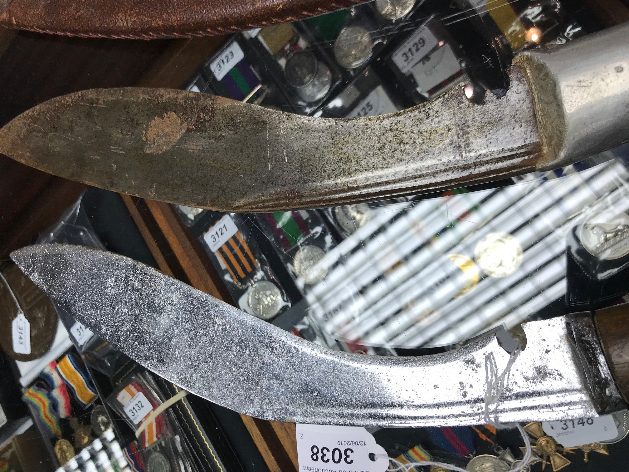 Lot 3038 - A large kukri, crescent moon armory marking to the blade; another,