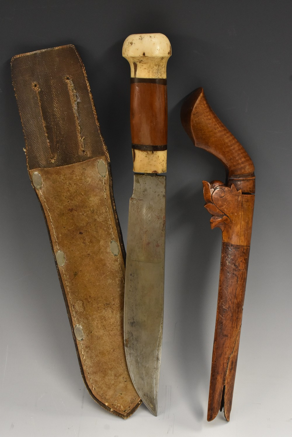 Lot 3017 - A Colonial dagger or utility knife, 23cm machete type blade, bone and hardwood hilt, 35.