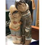 Lladro figure group of two Eskimos with arms around each other. Height 33 cm