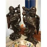 Pair of Oriental Rootmen figures